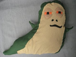 Jabba the Hutt Pillow - Photo 20 of 21 - I hand stitched these on where the seam hit on the sides. Hahaha, lookit this guy! What a goof!