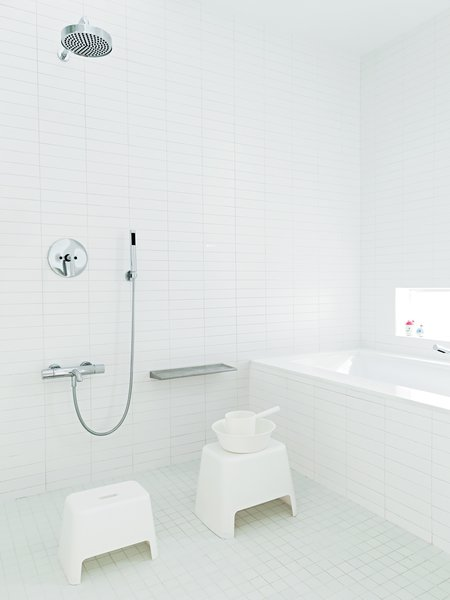 The Lais designed their house to be theirs forever. As such, they were able to make design moves that made sense for themselves but that wouldn't have high resale value, like the Japanese-style master bathroom in the middle of the second floor instead of off of the master bedroom. The traditional setup features bath stools from Muji for washing off.