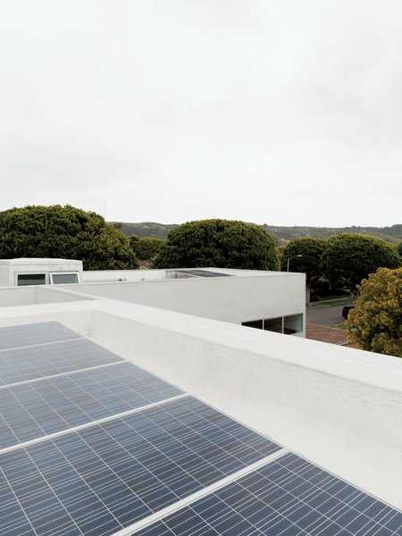The roof features a cool roof, which reflects heat back to the sky rather than having it absorbed into the house, and 26 solar panels that often cause the meter to roll backward.
