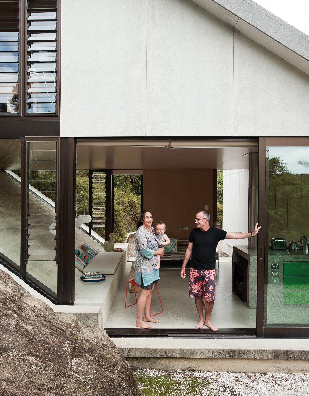 The house Amanda Yates (with her partner, Adam Rose, and their baby, Awa) designed for her parents, David and Christine, occupies a hillside site with views over Maramaratotara Bay. Make Your Parents Happy by Building Them a House - Photo 6 of 25
