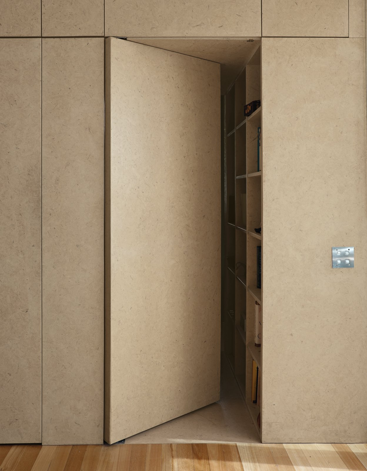 An almost-concealed door designed as a part of the kitchen cabinetry leads to the main bedroom and en-suite bath.