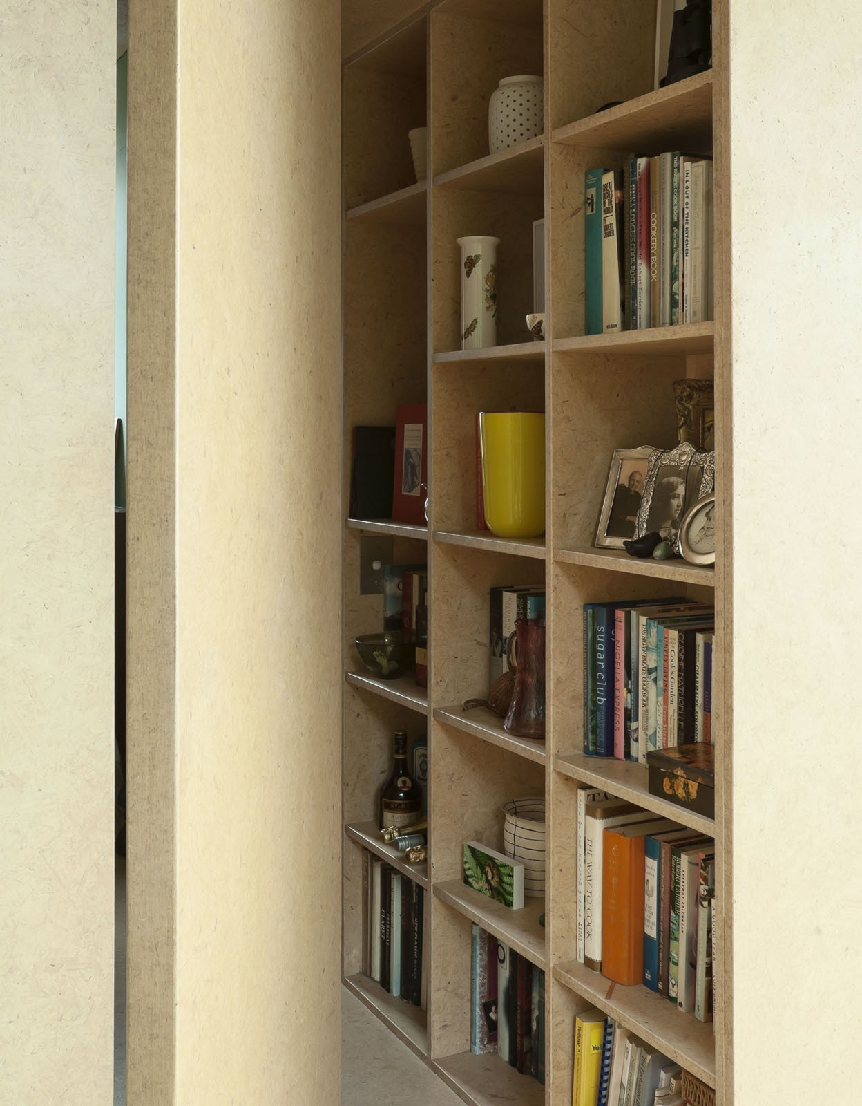 Yates used the same medium density fiberboard on this bookshelf as she did on the wall in the kitchen.