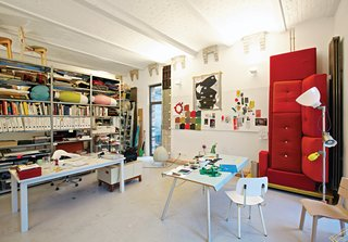 Dutch Designer Focus: Hella Jongerius - Photo 1 of 31 - Jongerius's studio is a vibrant jumble of prototypes, products, and samples, including a red Polder sofa for Vitra and, on the far right, a Blossom lamp for Belux and prototype for the Rotterdam Chair for Vitra.
