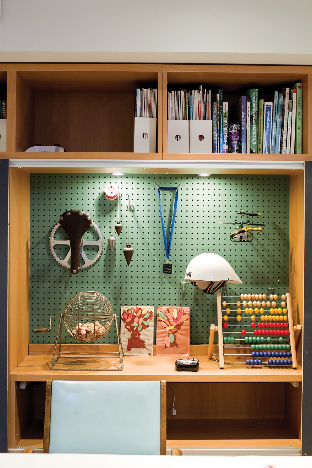 John built a shelf system for the basement when it was Anne's office; he adapted it to store the kids' toys when the area became a playroom. Play's the Thing - Photo 9 of 13