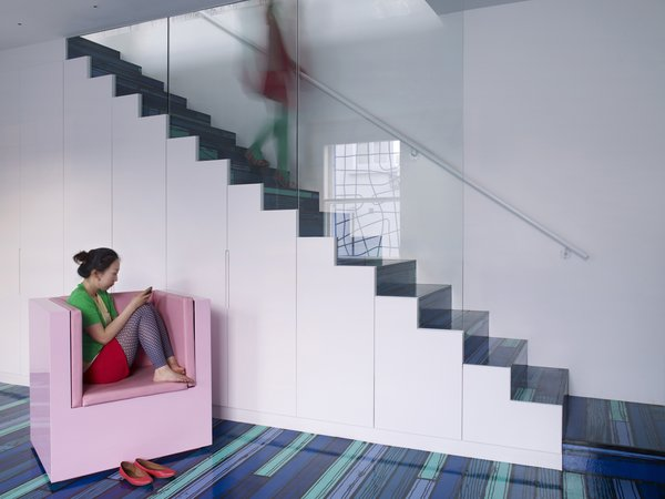 A Family Goes Somewhere Over the Rainbow - Photo 4 of 6 - The ground floor is a music room with a kind of blue vibe, thanks to the Richard Woods flooring.