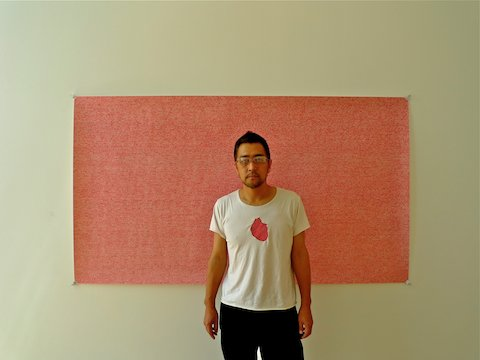Sasaki stands before a drawing of his own heartbeat at his studio in downtown Los Angeles.