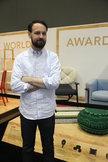 Dwell's Kyle Blue in front of the Modern World Awards exhibit at Dwell on Design.