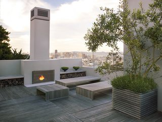 25 Blissful Backyards - Photo 17 of 25 - Looking out from the roof deck gives an expansive panorama of the San Francisco skyline, but a peek over the edge reveals the minimal lines of the backyard below.
