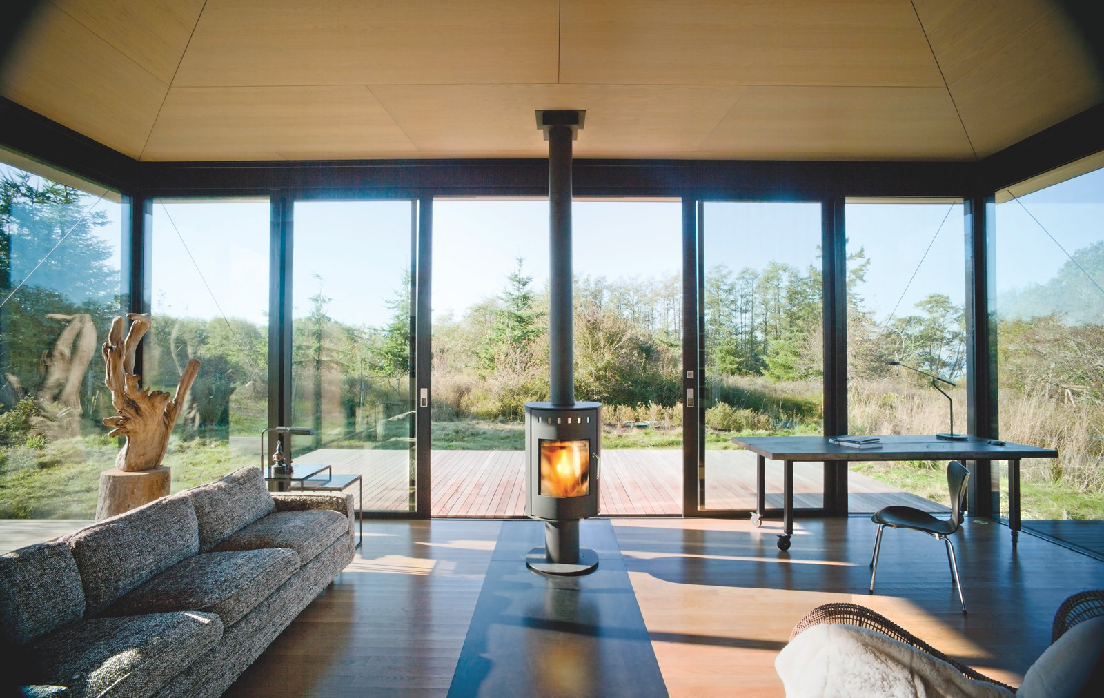 Architects: Kirsten Murray, Tom Kundig Tagged: Living Room, Wood Burning Fireplace, and Sofa.  Photo 2 of 3 in A Minimal Writer's Retreat in the Pacific Northwest