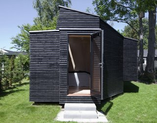 30 All-Black Exterior Modern Homes - Photo 8 of 30 - The design eschews right angles on the exterior and interior, which was one of the most challenging aspects of the design for Kallesø.