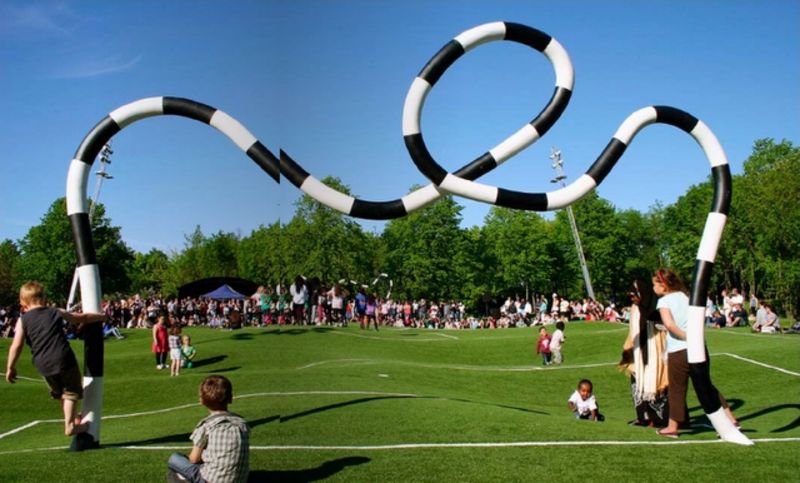 """""""Puckelball"""" is a variant of soccer played on a field that looks like it was attacked by giant moles with a goal designed by the Mad Hatter. Its creator, artist Johan Strom, thinks of it as a metaphor for life: <br><br>""""Many live under the belief that life is a fair playing field, that both pitch halves are just as big and the goal always has at least one cross. But ultimately the ball never bounces exactly where you want it to and the pitch is both bumpy and uneven."""" The world's only Puckelball pitch is in Malmö, Sweden, a city with many other great playgrounds and public spaces as well. Definitely worth a trip!"""