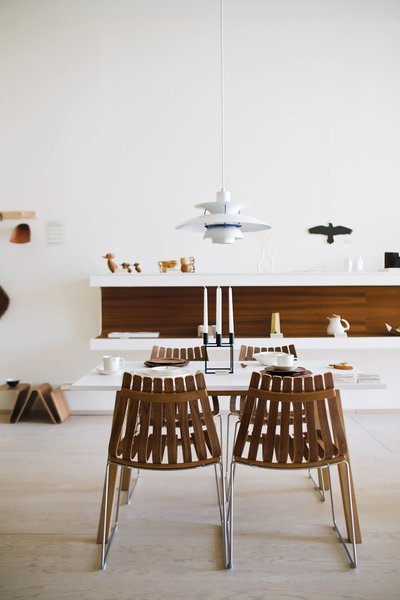 At the shop, Poul Henningsen's PH 5 lamp for Louis Poulsen hangs over the Sandra table by Thomas Sandell for Asplund and Scandia chairs by Hans Brattrud for Fjordfiesta (top left).