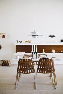 Design Shop Visit: Mjölk in Toronto - Photo 9 of 9 - At the shop, Poul Henningsen's PH 5 lamp for Louis Poulsen hangs over the Sandra table by Thomas Sandell for Asplund and Scandia chairs by Hans Brattrud for Fjordfiesta (top left).