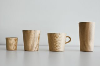 Oji Masanori's wooden Kami cups and mugs are handcrafted in Japan and are made from castor aralia wood, shaped using a potter's wheel and coated with a food safe resin.