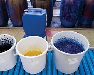 "The inks are stored in plastic wrap–covered buckets, which prevents a thick, top layer from forming. Each day, the color kitchen prepares hundreds of pounds of ink for the hues needed for the following day's printing. ""Thanks to having our own facilities, we can react quickly to sales,"" Salmi says."
