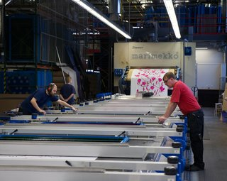 The more complex the design and the more colors used, the more plates—and hands (up to four professionals at a time)—are required to run the 80-foot-long printer.