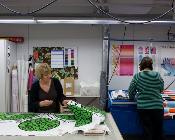 Workers in the on-site sewing area prepare textiles to become linens, bags, and more.