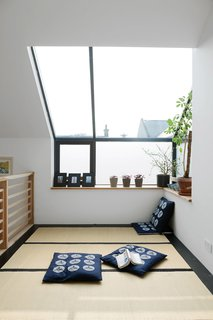 "The tatami room (pictured) has mats from the Futon Company and a ""Hinamatsuri"" mobile adds a cheery touch."