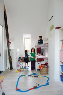 The kids make all the fun they need in their bedroom. Their bunk beds and shelving were bought at Ikea.