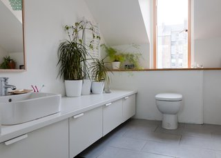 A Piece of Home - Photo 12 of 22 - Though most of the home's interior comes without a splashy designer's name attached, the bathroom is kitted out with a toilet, sink, and bath/shower from Jasper Morrison's line for Ideal Standard. The cabinets are from an Ikea kitchen system.