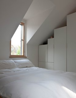 Konishi and Gaffney's bedroom is fairly austere, though a pair of dormers let in lovely natural light.