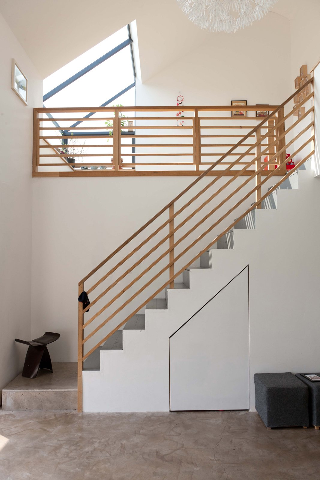 The spatial drama on the interior comes from the staircase and tatami room upstairs. The daffodil pendant overlooking it all is from Ikea. The butterfly stool is by Sori Yanagi and was a birthday present from Konishi to Gaffney.  190+ Best Modern Staircase Ideas by Dwell from A Piece of Home
