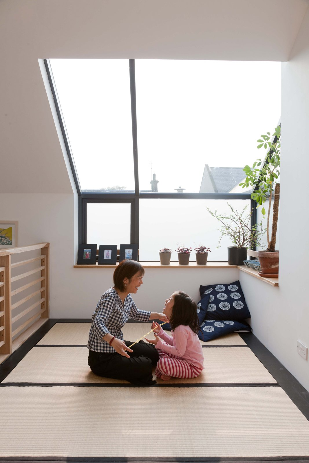 Konishi and Mika play a string game in the tatami room under a skylight meant for moon gazing.  Don't miss a word of Dwell! Download our  FREE app from iTunes, friend us on Facebook, or follow us on Twitter!  Japanese Homes by Dwell from A Piece of Home
