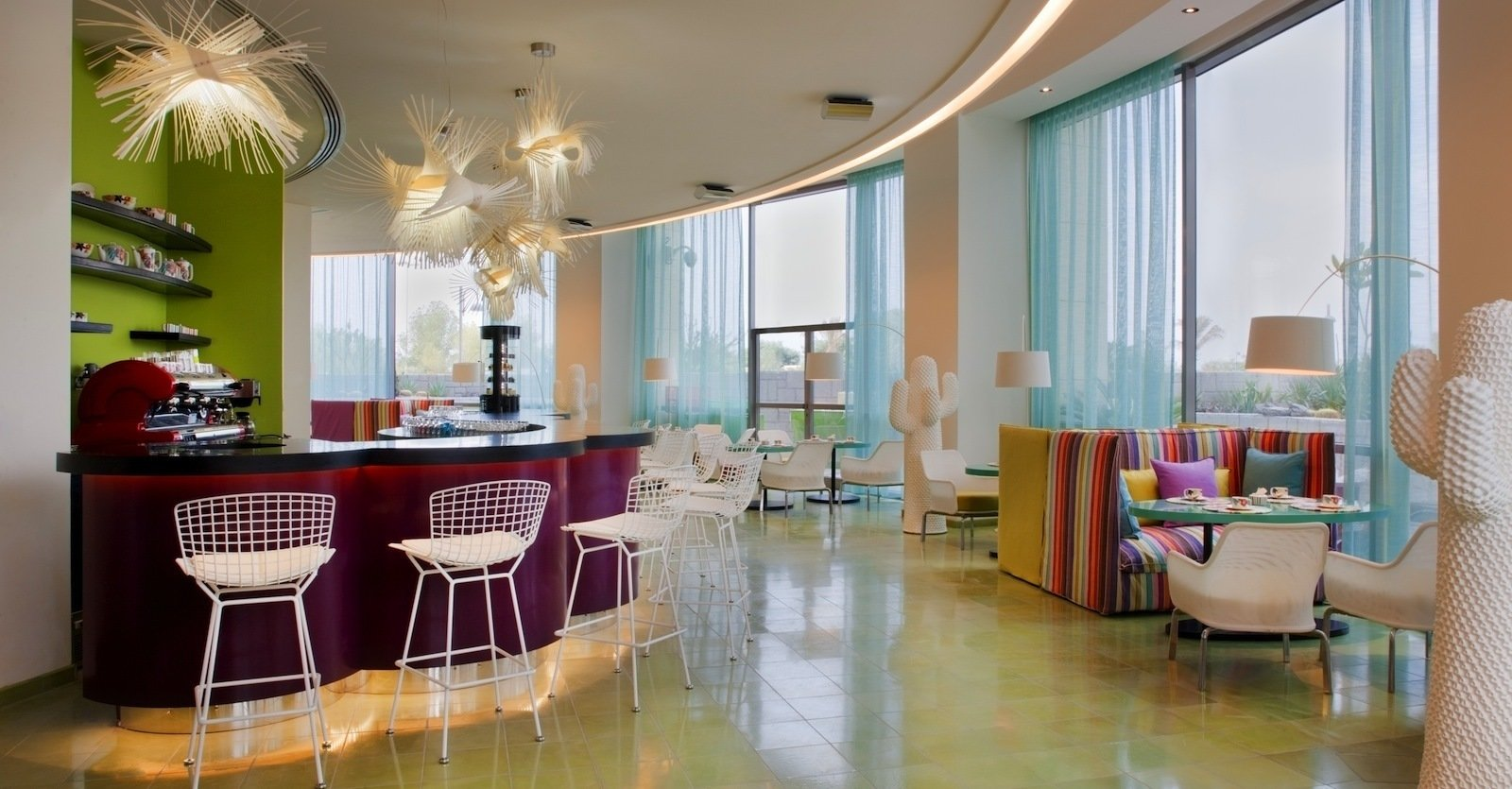The Choco Bar offers Kuwait a chance to sample two of the best Italian delicacies: chocolate and coffee. The white floor lamps are Marc Saddler Twiggy lamps. The barstools are Bertoia wire chairs. Photo by Gerry O'Leary.  Office by Muhajir Anuar from Hotel Missoni Kuwait