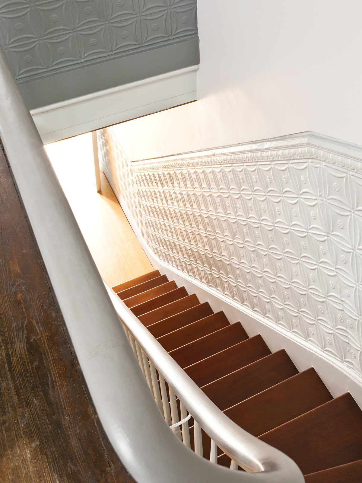 The tin panels lining the stairs are original to the house. Tagged: Staircase and Wood Tread.  Lounge by Jim Tattersall from New Prospects