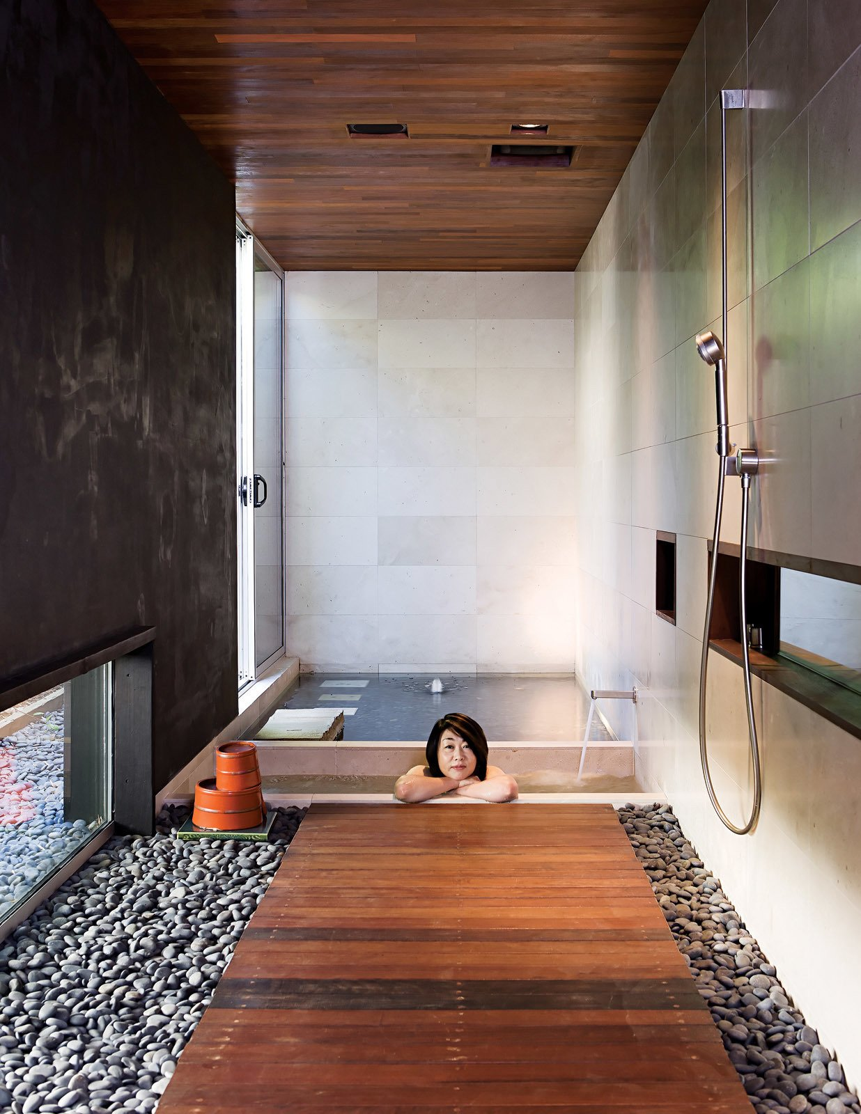 At the opposite end of the house, the soaking tub gets almost daily use. The bath and shower fixtures are by Dornbracht Tagged: Bath Room and Soaking Tub.  Photo 11 of 13 in Japanese Soaking Tubs from An Atypical Modern Home in Southern California