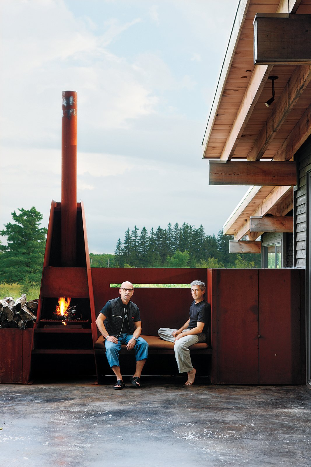 """Metals broker S. J. Sherbanuk (left) and designer James Campbell (right) created a new home in Collingwood, Ontario, with old scrap. """"Repurpose, refurbish, recycle"""" was the guiding principle for the project.  97+ Modern Fireplace Ideas by Dwell from Seven Great Outdoor Spaces"""