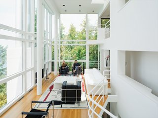 Richard Meier's Practice at 50 - Photo 10 of 10 - Michael McCarthy and Marcia Myers spent years rehabilitating the Douglas House, built in 1973 and one of Meier's first major residential commissions. The double-height living room features a custom sofa and low table of Meier's design. Read the full story from our October 2011 issue here.