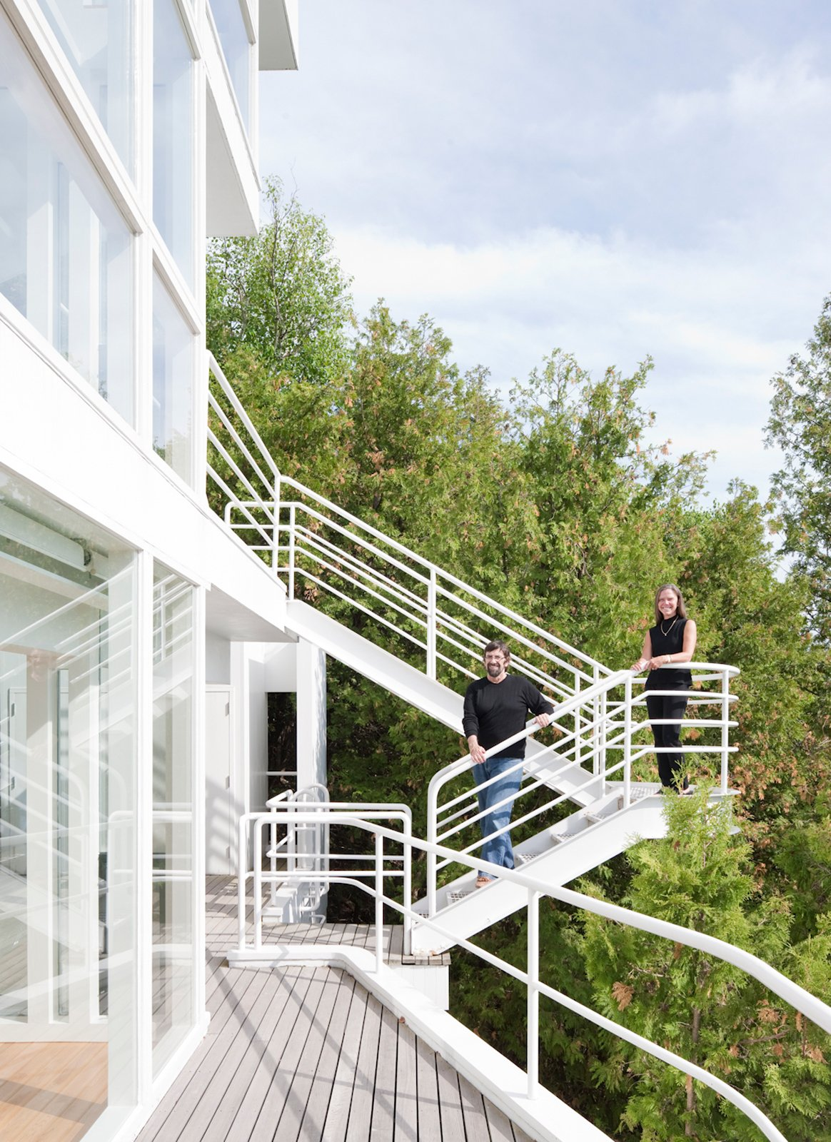 Michael McCarthy and Marcia Myers on the exterior promenade.  Photo 11 of 22 in This Lake House Is a Living Piece of Architecture History