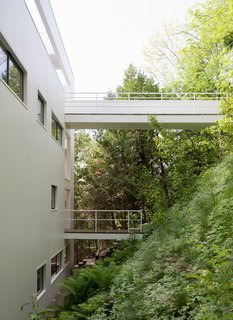 There are two walkways that extend over the sloping hillside. The top-most walkway is the intended entrance.