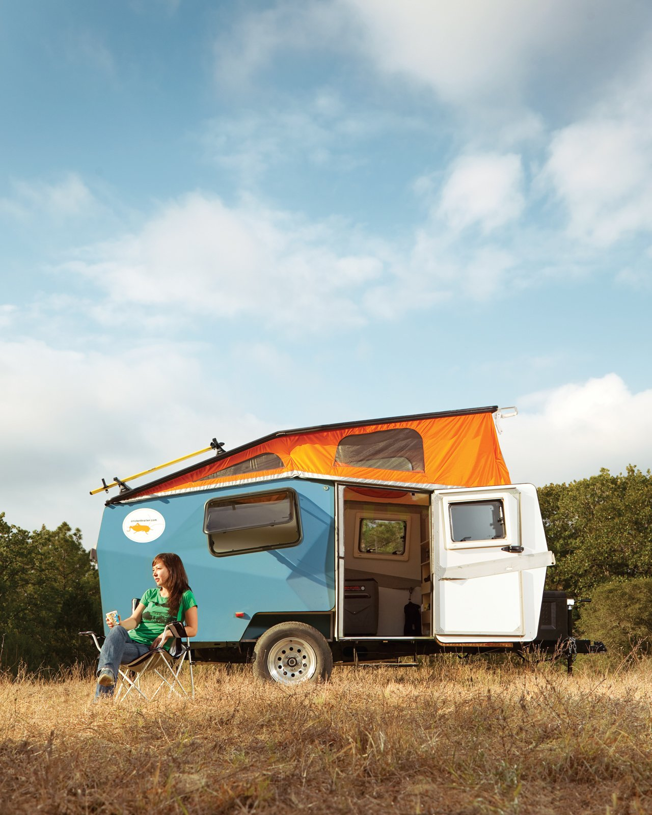"""In early May, I headed down to Texas to report the October 2011 issue Off the Grid story about a sustainable home in Austin and then drove an hour out of the city to spend a night camping in a Cricket Trailer, a small, self-contained pop-up camper. Cricket Trailer founder and designer Garrett Finney drove from Houston, where he manufactures the trailers in a 5,000-square-foot factory, and met me at the 9E Ranch in Smithville. After orienting me to what he calls """"a portable adventure living space,"""" he took off and I spent the evening camping out and testing all the Cricket Trailer has to offer. Tagged: Exterior and Camper Building Type.  Adventure by DAVE MORIN from Modern NASA-Inspired Cricket Trailer"""