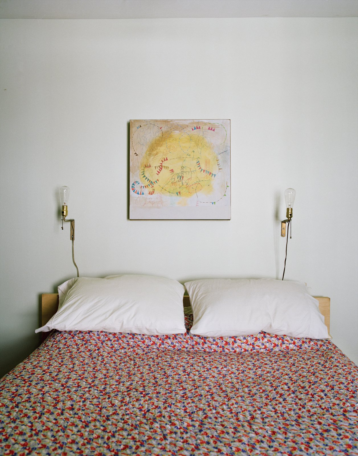 The master bedroom. The coverlet is from Urban Outfitters. The painting is by Helen Rice.  Photo 10 of 18 in Raise High the Roof Beams