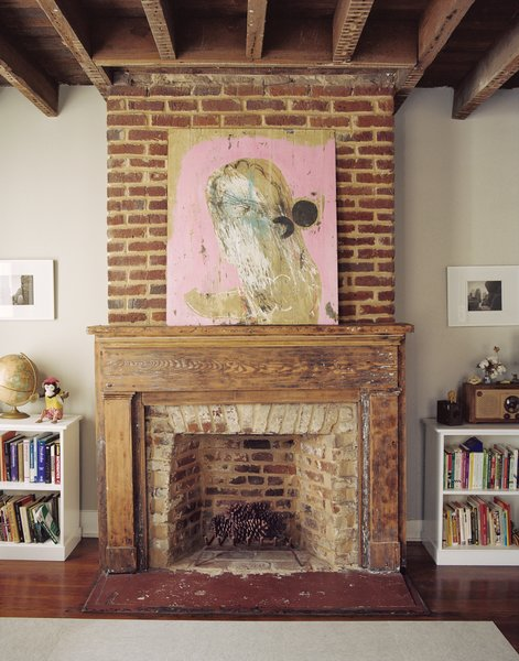 The couple plans on relining the flues this winter, but in the meantime the mantels serve as much needed horizontal space.