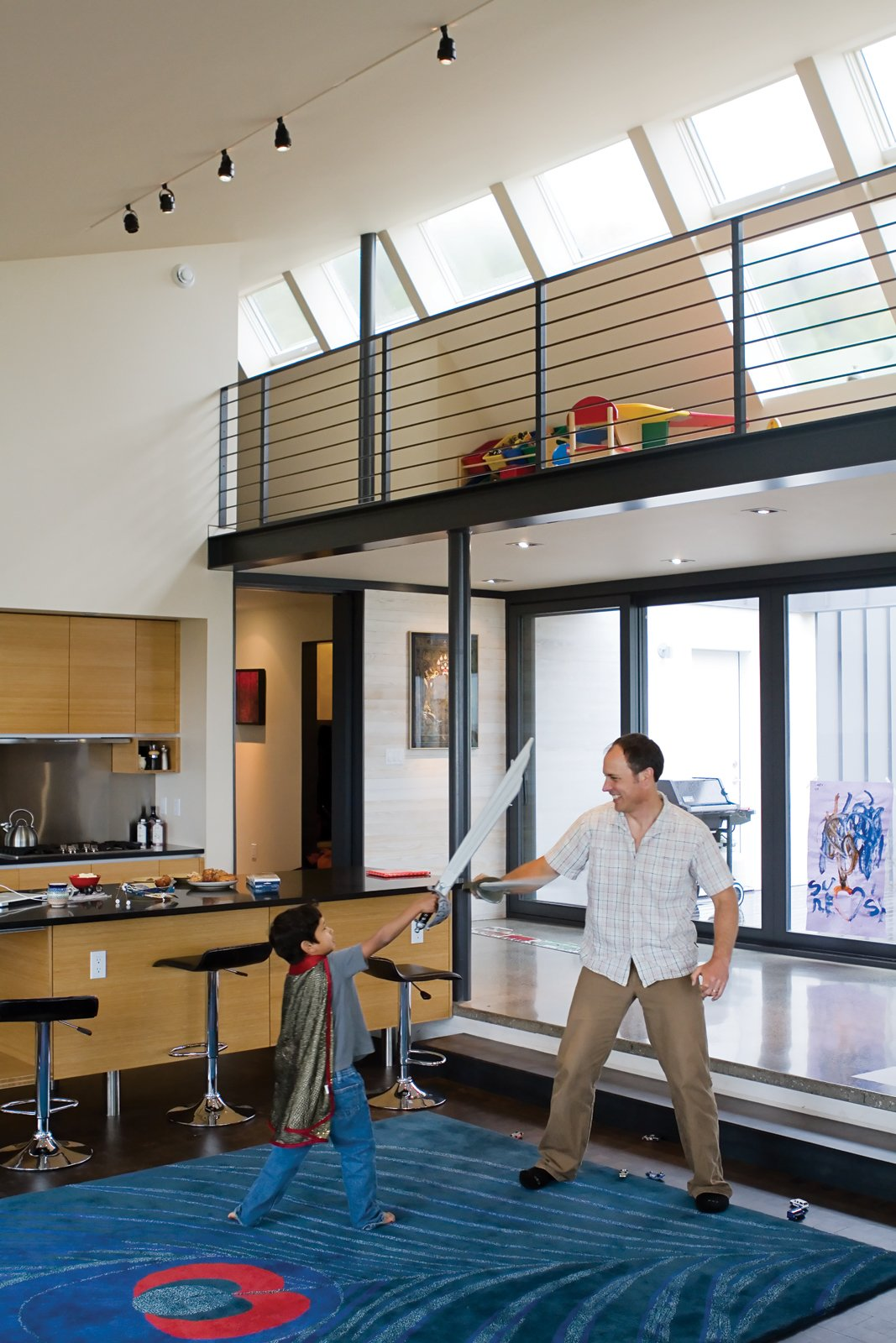 The thick peacock rug from CB2 offers a cushioned surface for energetic play. An Epic Plot - Photo 2 of 10