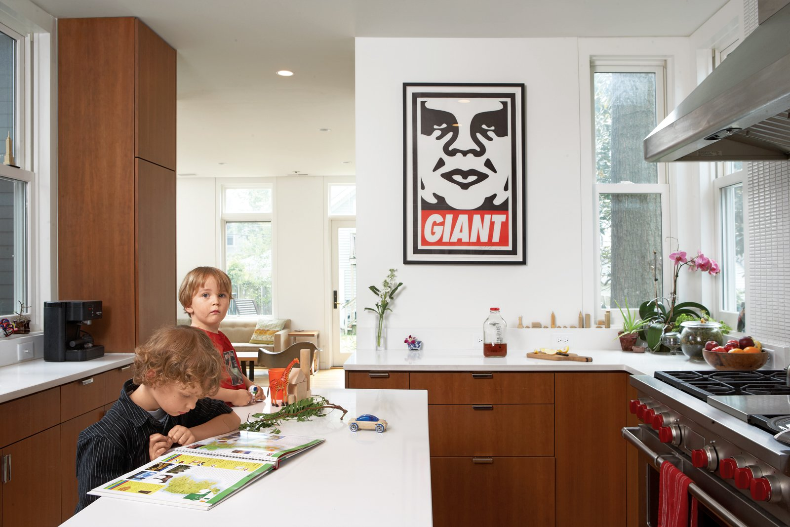 """The cherry veneer cabinets carry into the streamlined kitchen where a Shepard Fairey print and a range by Wolf take pride of place. """"We tried to make sure that all the wood used in the project looked seamless and uniform,"""" says de Leon. """"Wood was the only 'color' we introduced."""""""