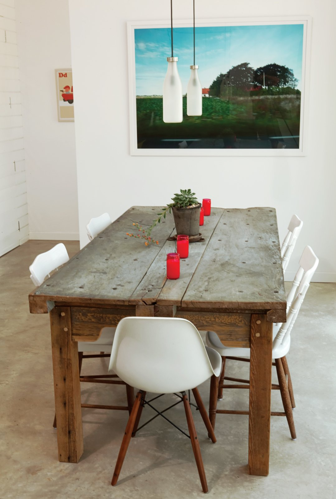 The dining table in the Suttles and Shah residence made from two old Mexican doors. Tagged: Dining Room, Table, Chair, and Pendant Lighting.  Photo 2 of 7 in A Green Home to Last a Lifetime in Austin