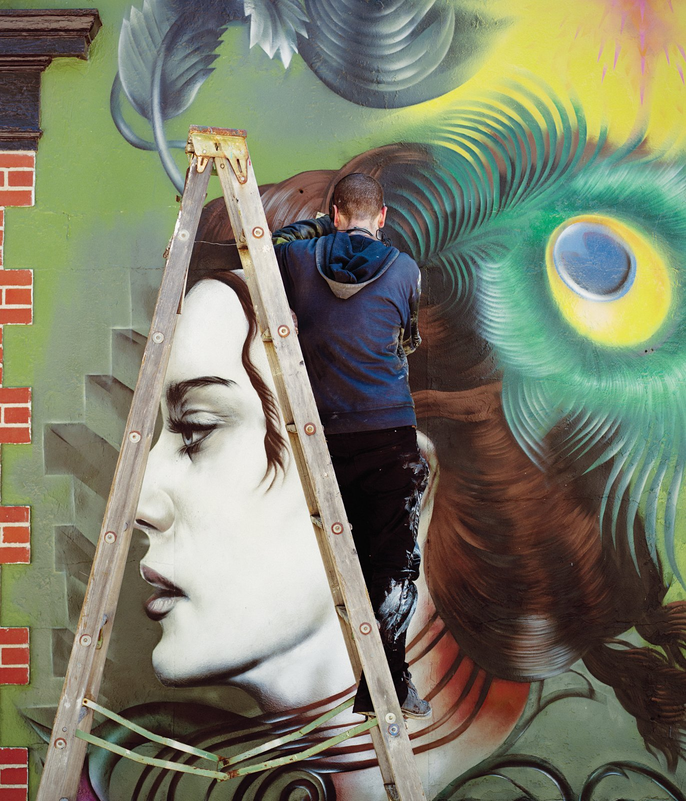 The new outdoor wall mural in progress by artist Seth Depiesse on Main Street. Building Community - Photo 5 of 13