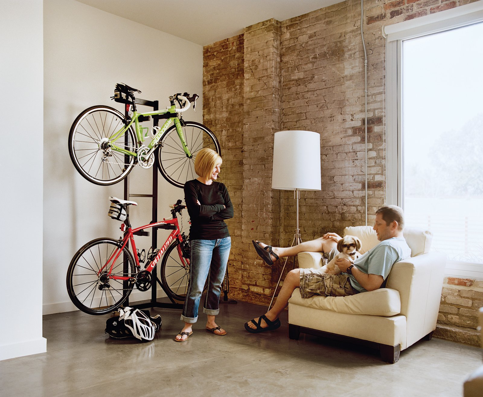 "Loft B tenants Melissa and Keith Bishop downsized from a 3,000 square foot space to a cozy 720 square foot loft. ""We downsized our lives,"" Melissa says. ""We streamlined."" Tagged: Sofa, Storage Room, and Shelves Storage Type. Building Community - Photo 8 of 13"