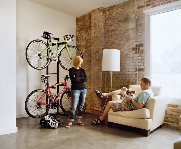 """Loft B tenants Melissa and Keith Bishop downsized from a 3,000 square foot space to a cozy 720 square foot loft. """"We downsized our lives,"""" Melissa says. """"We streamlined."""""""