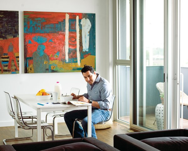 """The clean lines and, in Loft R's case, balcony with a view of downtown's skyline suit Robert Vanselow's urbane sensibility. """"This was spot on,"""" he says."""