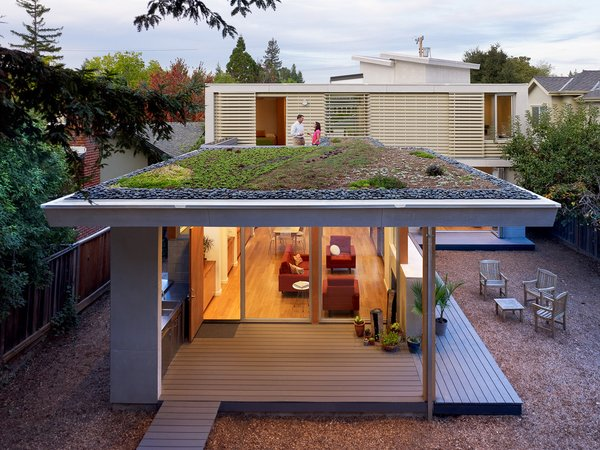 """Rian and Melissa Jorgensen's 2 Bar House in Menlo Park boasts all the usual green design suspects: energy-efficient lighting, good insulation, renewable material finishes, radiant heat, and the roof is pre-wired for future PV panels. Executed by Feldman Architecture, the house requires only natural lighting during the day which keeps energy costs way down. Still, the most stunning aspect of the green design is the living roof planted with succulents, aloe, viviums, and ice plants. """"I'm absolutely glad that we did it,"""" says Melissa. """"It turned out so well and I really enjoy sitting up there and taking advantage of it as much as I can. It's very peaceful."""" Read more about this total remodel here."""