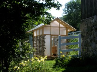 The Dos and Don'ts of Building Your Own Chicken Coop - Photo 3 of 4 - Architect Keith Moskow, a partner at Moskow Linn Architects for more than 20 years, and cofounder Robert Linn decided it was time to help a new generation of designers. Earlier this year, they established Studio North, a design-build branch of their practice, and with five eager students, created and constructed the Chicken Chapel. The entire structure takes on the look of a Japanese lantern in the evening. The team added lights so you could go in and be able to see where you are at night and also so that come late fall and winter, Moskow can turn them on after the sun sets to maintain the chicken's waking, eating, and egg-laying hours even as the days shorten.