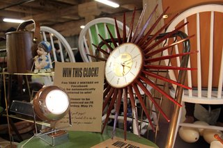 Smarty pants vendors Take 2 Vintage (Robin Witt and Joe Moore) had a contest going in their booth. They offered up this timeless mid-century clock to one lucky Facebook fan. <br><br>Photo by <br><br>Felix Jung
