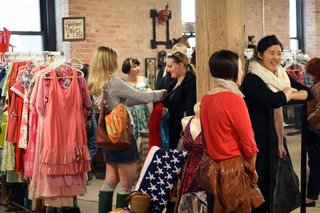 Vintage clothing and accessories vendors are abundant at the Bazaar, like Nicole Hughes' Bombshellshocked booth where gals congregated to pick from her retro threads and have a few laughs. <br><br>Photo by <br><br>Steven Pate