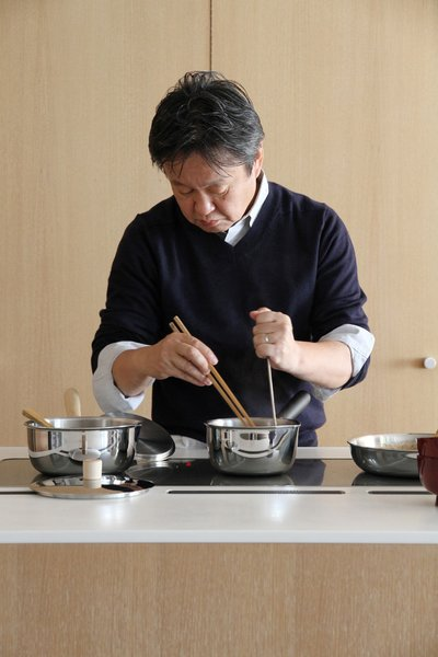 Shown here, Fukasawa busy over the cooktop.