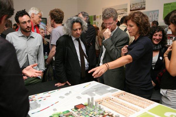 Shaun Donovan, Jeanne Gang, and Mohsen Mostafavi, Dean of the Harvard Graduate School of Design, present Studio Gang's proposal for the exhibition.